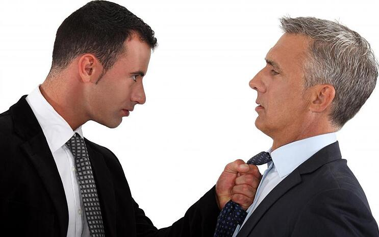 younger-man-grabbing-tie-of-an-older-man-1.jpg